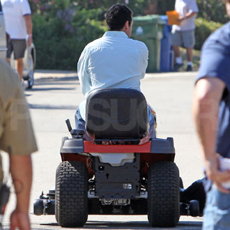 Guess Who's Riding Around the Set on a Lawn Mower?