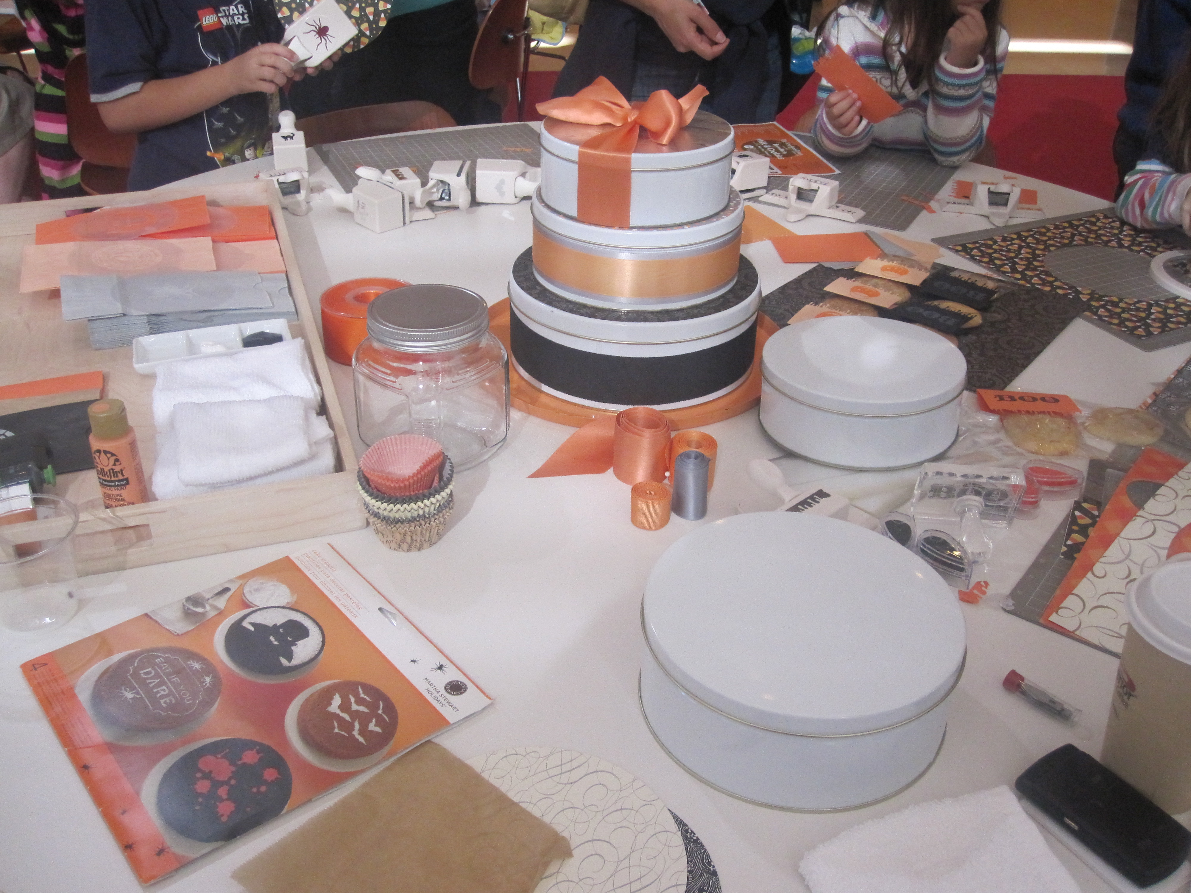 In the center of the room, the crafting stations were set up. This one was covered in cookie packaging tools like ribbon, tins, and decorative paper.