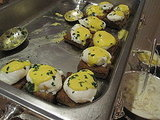 I tried the poached eggs with hollandaise sauce. They were served on fried short rib cakes. Yum!