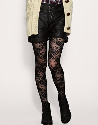 I would wear these Asos Daisy Lace Tights ($17) with everything from leather to a solid-colored dress. Maybe red? Just avoid prints as you don't want to appear too busy.
