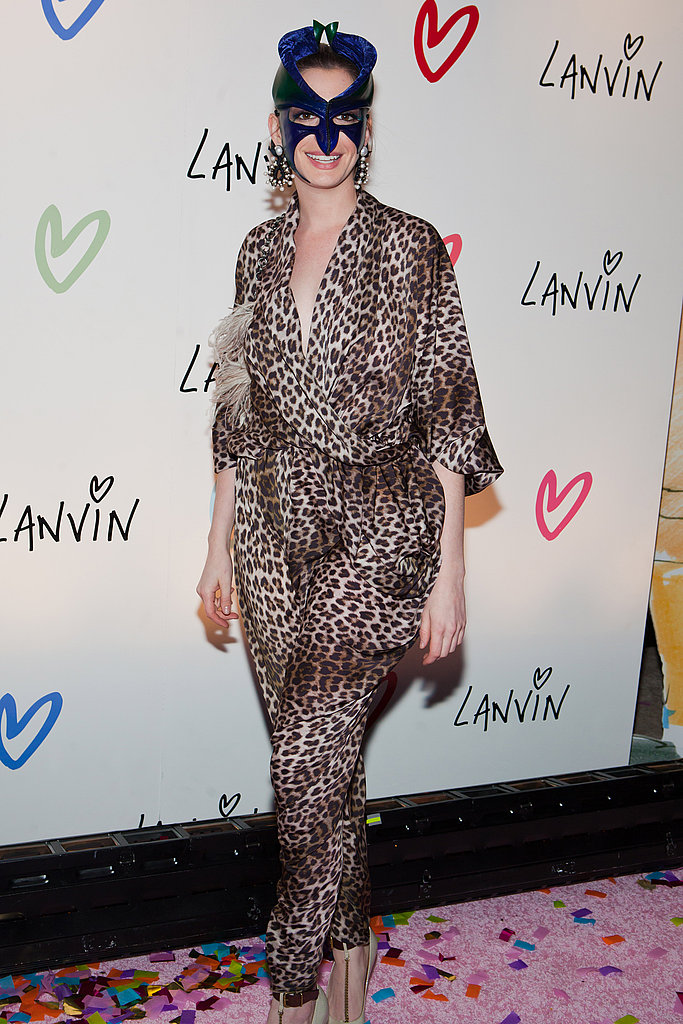 Meow! Anne Hathaway looked Fab and ferocious in a silky leopard jumpsuit and mask.