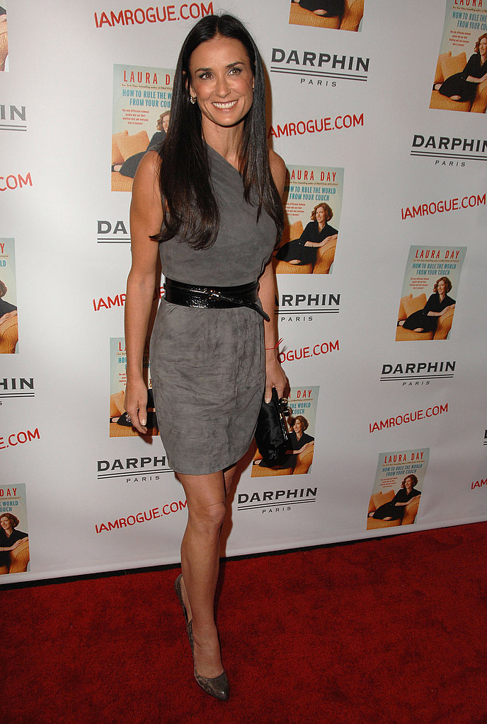 Simply stunning in a grey, one-shouldered mini for a book launch in October 2009.