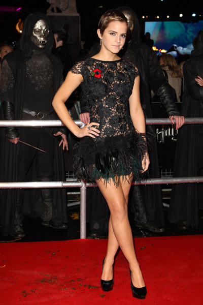 Emma Watson, gorgeous — and all grown up — in a feather-skirted lacy LBD.