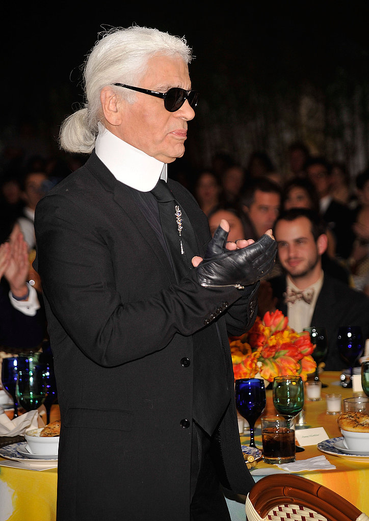A standout in the crowd: Karl Lagerfeld offers a round of applause.