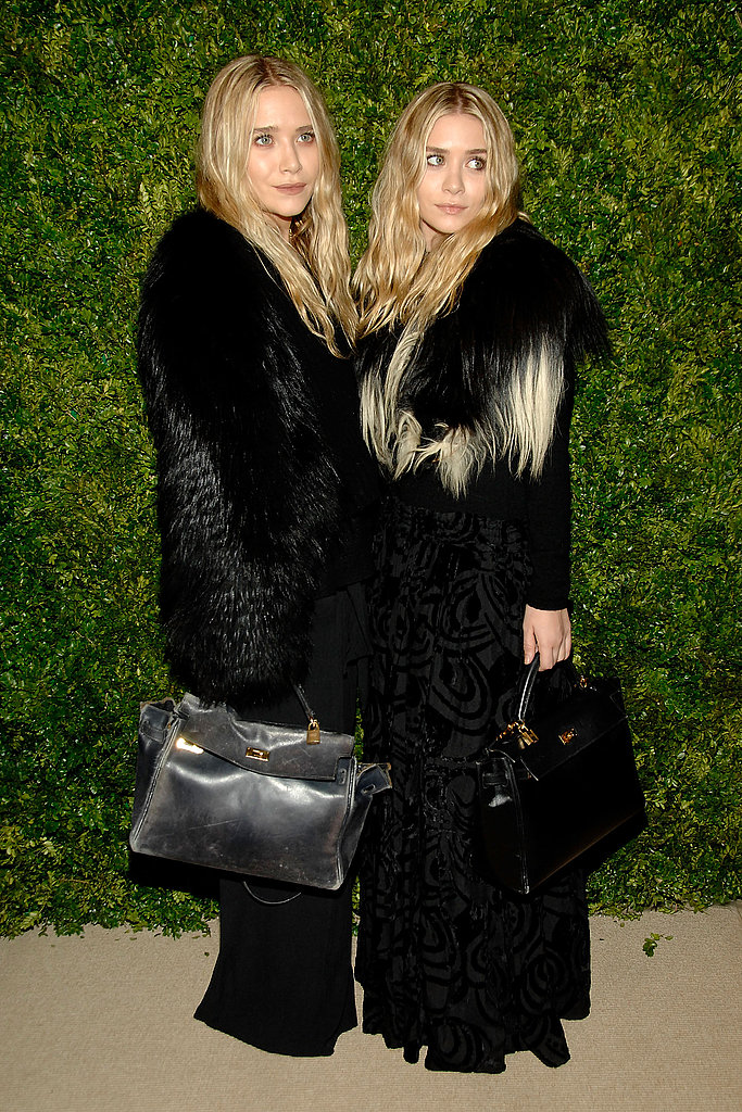 Mary-Kate and Ashley kept things coordinated in black fur.