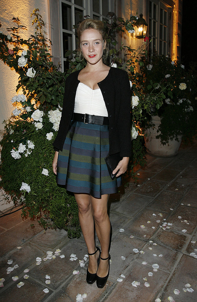 Celebrating the launch of Viktor & Rolf for H&M in ladylike plaid and a cardi in Oct. '06.