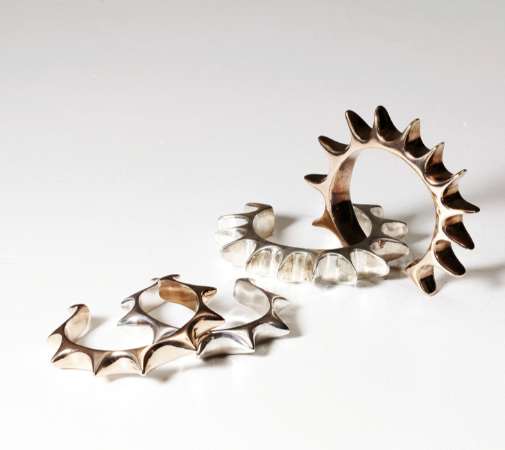 Sun Cuff (left), Flat Spike Cuff (right)