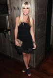 Tinsley Mortimer's black strapless gets some fun via a feather-trimmed hem.