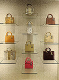A wall of Dior handbags, just heavenly.