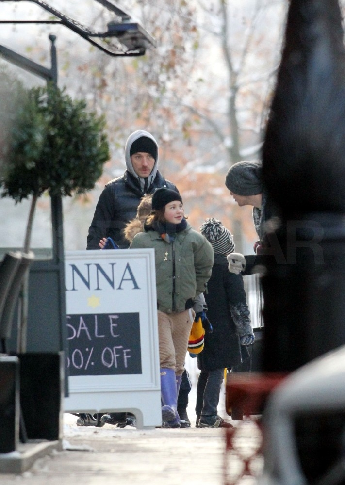 Sienna Jets In to Join Jude and His Kids in Snowy London