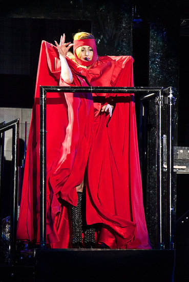 Lady in red? The most covered up Gaga's ever been!