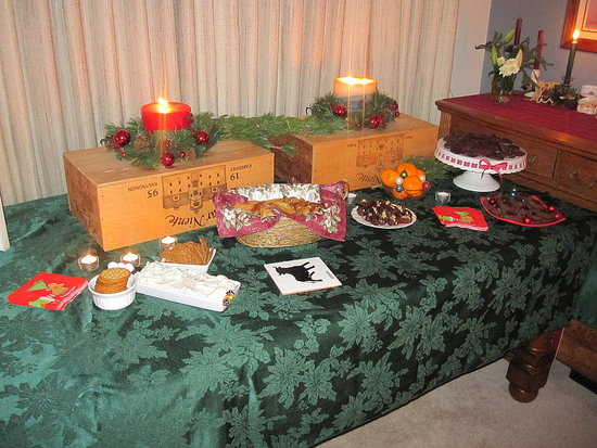 It's nice to add height to a buffet. Here, we turned leftover wine crates upside down. Then we placed giant candles on top. I think it looked pretty nice!