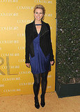 Niki Taylor strutted her stuff in a navy blue dress, black tights, and a black zippered jacket.