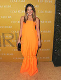 "Drew Barrymore glowed in a bright orange Jil Sander maxidress, Lucifer Vir Honestus 18k gold ""Vene"" ring, and Jack Vartanian diamond earrings."