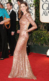 Anne Hathaway Shows a Bold Shoulder in Armani at the Golden Globes
