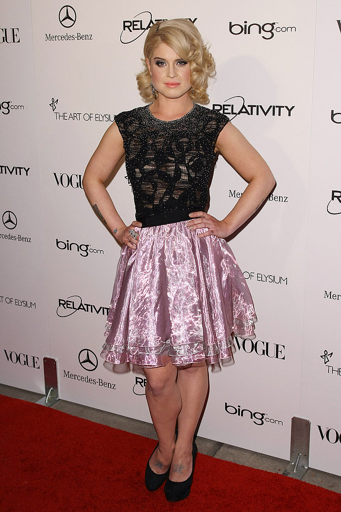 Kelly Osbourne in a pink and black DEVON dress.