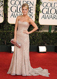 Carrie Underwood's nude Badgley Mischka glowed with shimmering sequins.