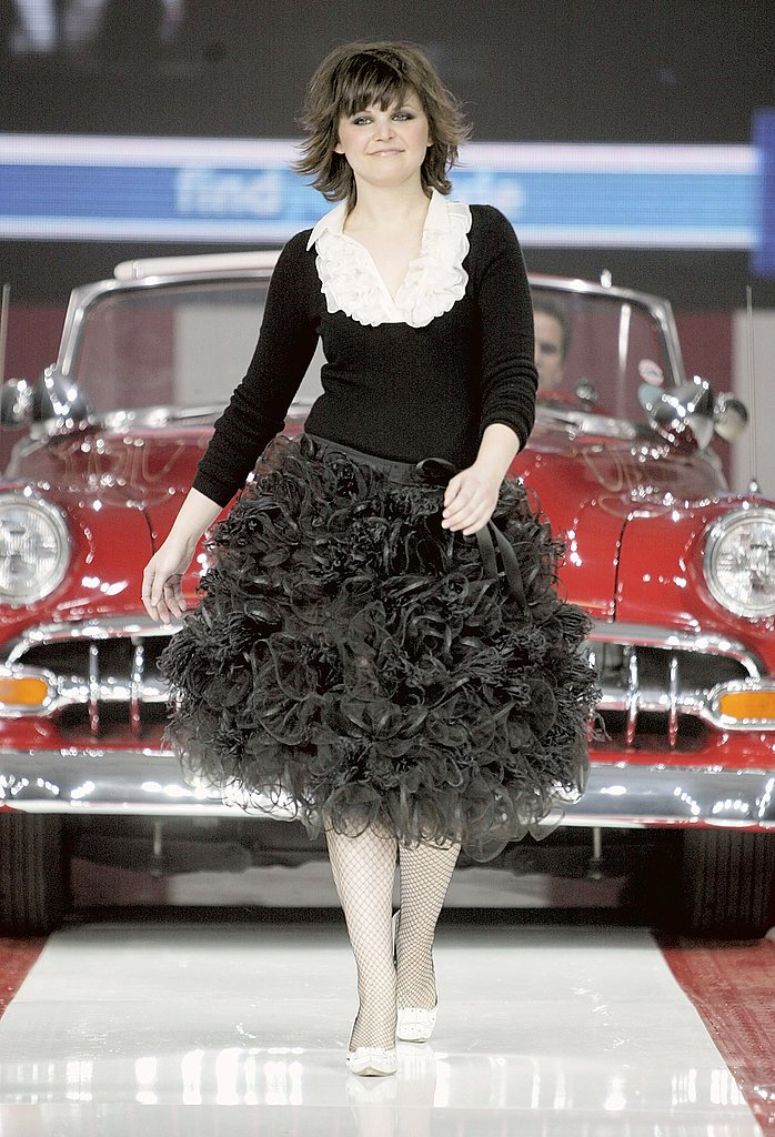 Ginnifer!!!  What is this?!  Walking a runway in 2004.