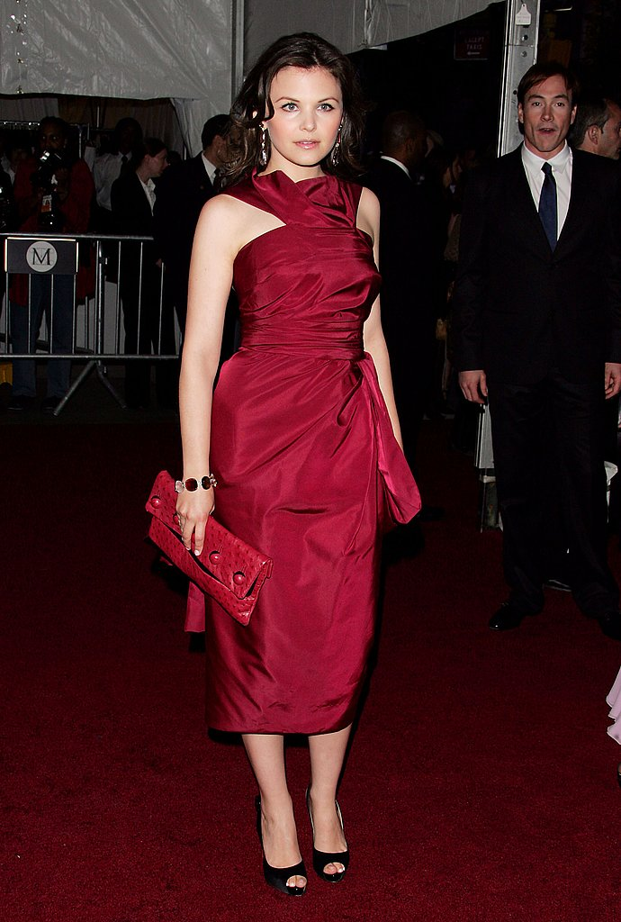 And she plays the red-hot siren a month later at the Met Ball 2007.