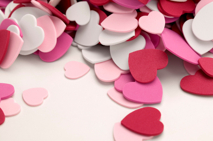 Decorate with lots of red and pink hearts. Whether you pick up some festive decorations from a local party supply store or simply cut paper hearts out of construction paper, don't overlook the atmosphere.