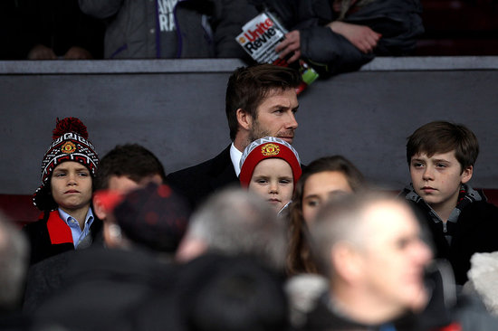 Victoria Talks About Her Baby at Her Fashion Week Show as David Watches Soccer With the Boys