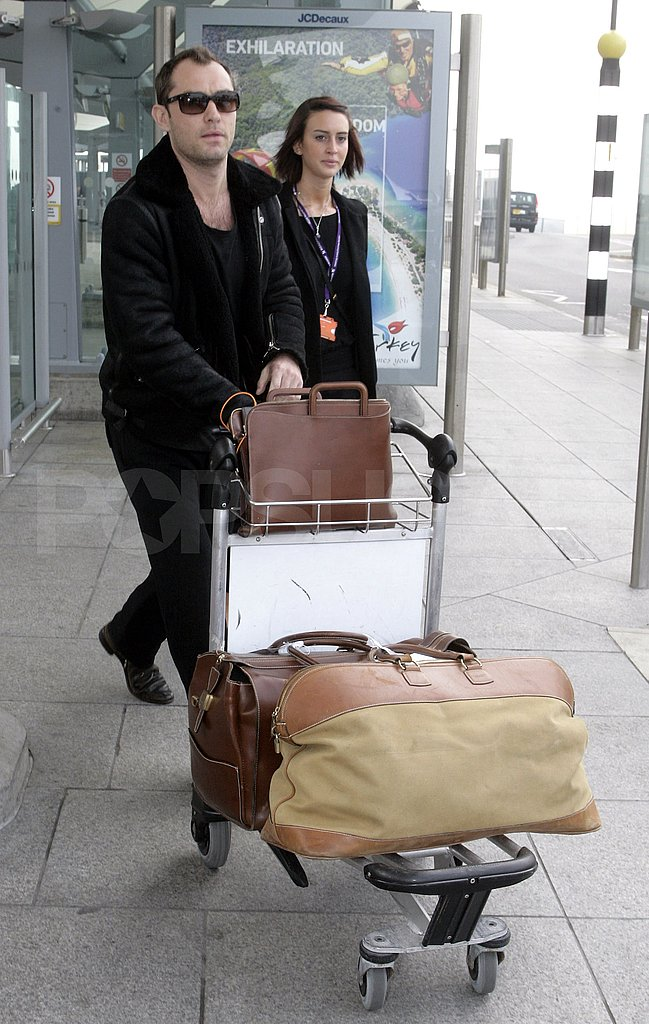 Jude Law Jets to London For a Face-to-Face With Sienna Miller