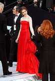Anne Hathaway: Her first — and best — look of the show came courtesy of a vintage scarlet taffeta Valentino number.