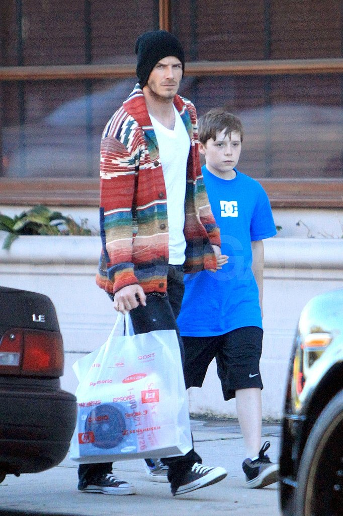 David Beckham Brightly Does Some Shopping With Brooklyn