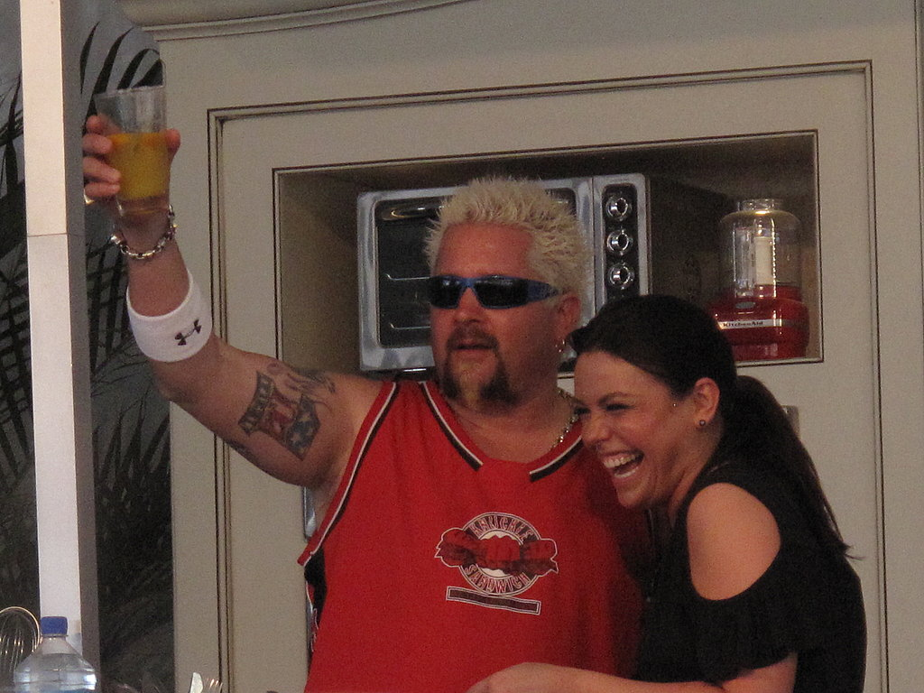Guy Fieri and Rachael Ray raise a kumquat margarita.