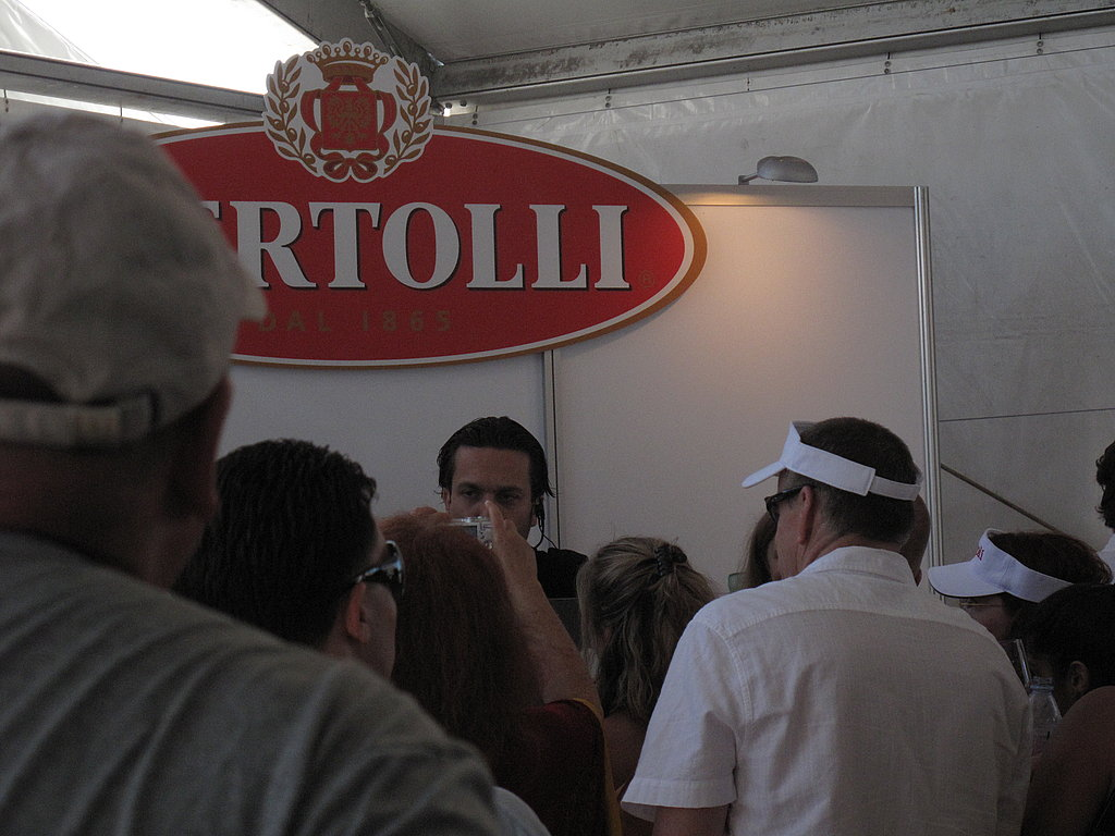 The mob scene around Top Cheffer (and YumSugar guest writer!) Fabio Viviani at the Bertolli booth in the tasting tent.