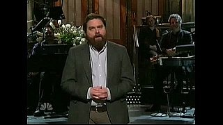 "Zach Galifianakis Sings ""Tomorrow"" From Annie in a Little Red Dress"