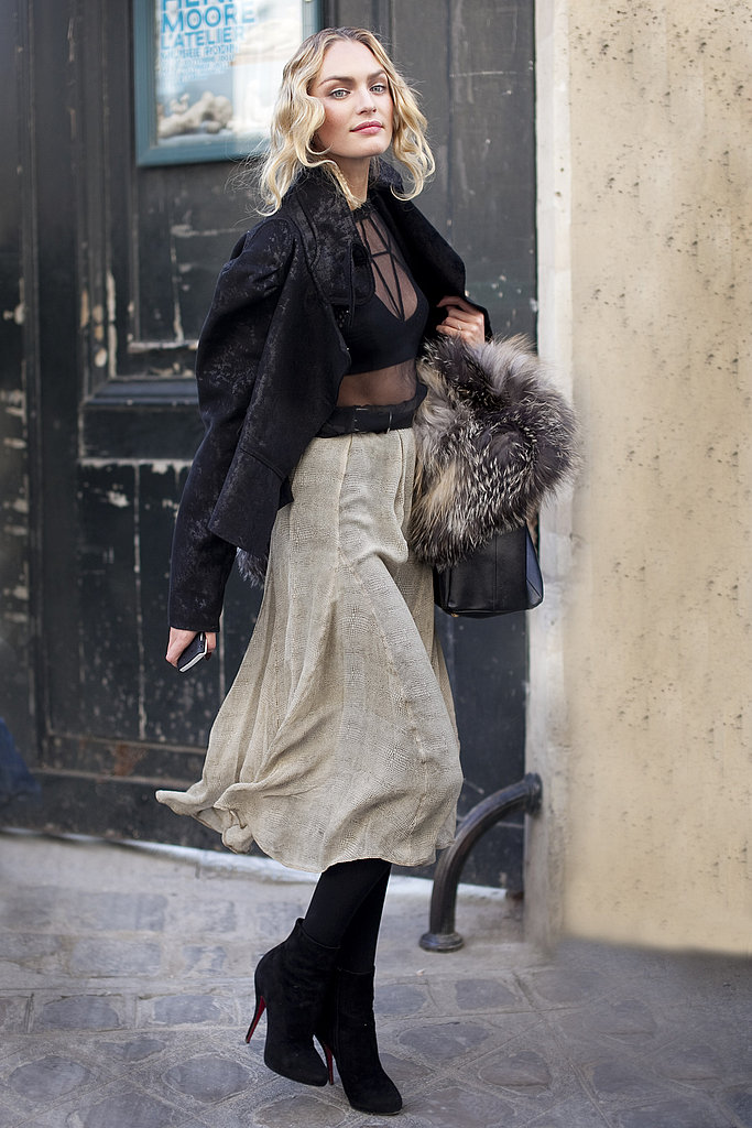 A calf-length skirt gets a super-sultry, super-luxe finish thanks to a sheer top and fur.