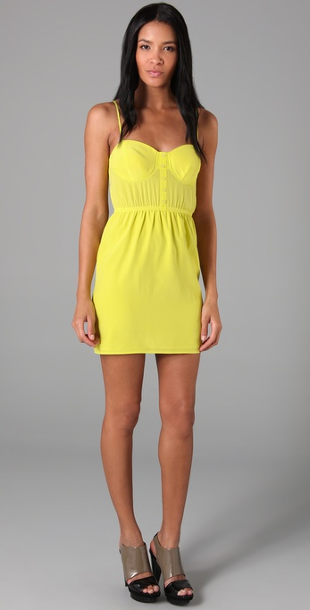 This little mini is right on trend in a super-bright citrus hue.