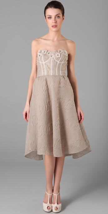 We love this sweet alternative to the traditional wedding gowns, everything from the calf-length hemline to the gorgeous embroidered details.  Lela Rose Embroidered Bustier Dress ($1,895)