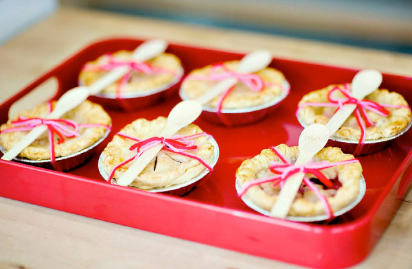 These mini pie favors are too cute with their pink and red yarn and individual spoons. Photo by Justin and Mary Marantz