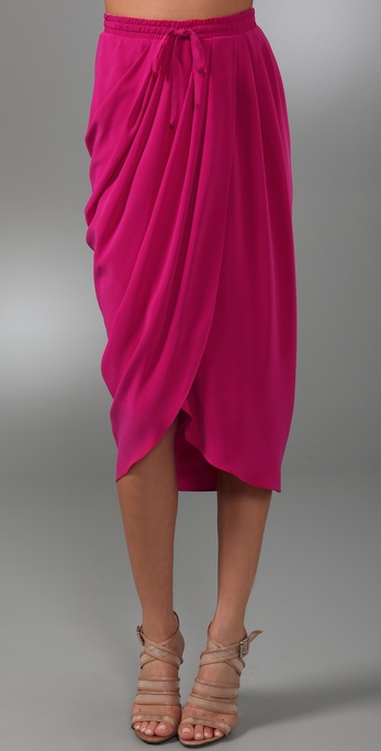 After peeping a cohort donning a similar hot fuchsia skirt the other day, we knew we had to add this Thakoon Draped Skirt ($390) to our list.