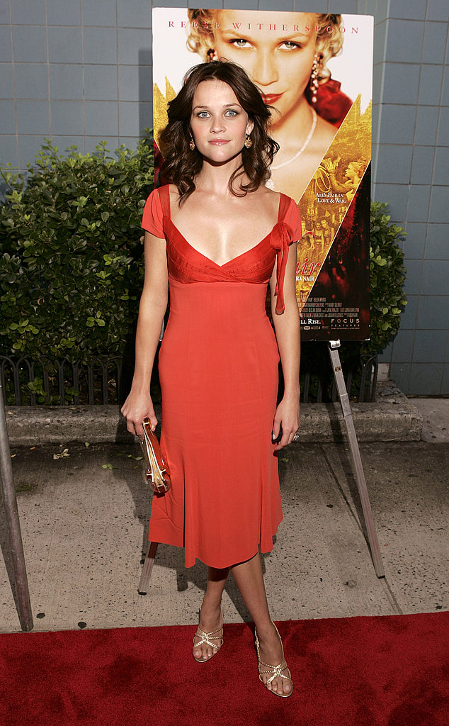The bright orange hue of this mid-length dress showed off an ample amount of décolletage at the NYC premiere of Vanity Fair in 2004.