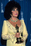 Elizabeth Taylor posed with her Humanitarian Award Oscar in 1993.