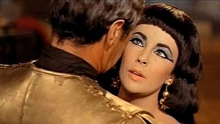 Video: Remembering Elizabeth Taylor's Iconic Beauty, Handsome Men and Glamorous Career