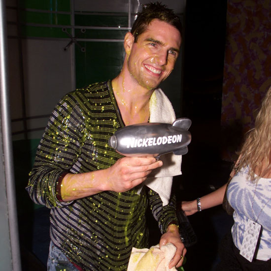 Tom Cruise was a good sport in 2001 after getting slimed on stage he happily accepted an award and smiled for fans.