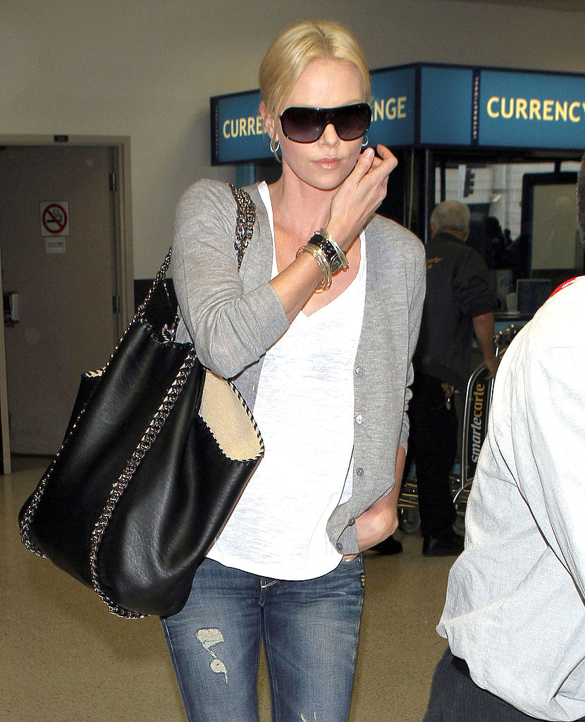 Charlize Theron Arrives Home and May Have Found Her Huntsman in Hugh