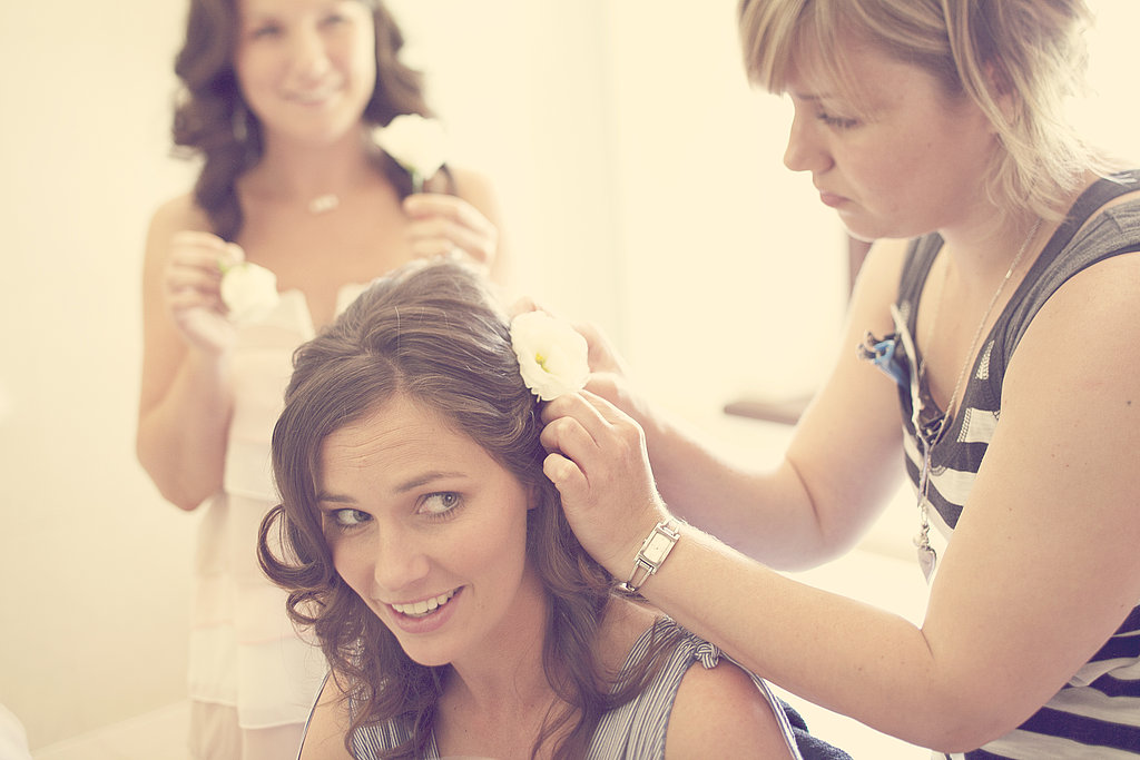 A behind-the-scenes peek in this bride's dressing room depicted just how classic a flower in the hair will always be.  Source: Flickr user Ryan Polei