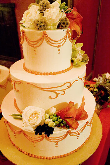 The cake: red velvet with cream cheese and pecan filling and buttercream icing by Two For Two Cakes.