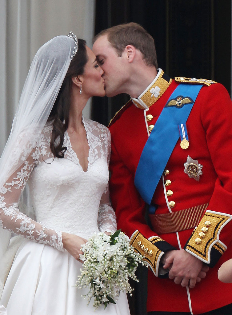 Prince William and Kate Middleton kiss on the balcony.