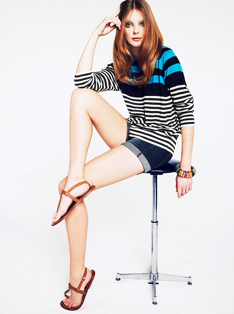 For a casual look, pair a bold, light sweater with denim shorties and flat sandals for effortless ease.