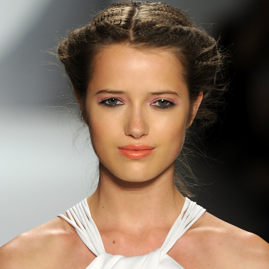 How do you wear a fresh, pretty hairstyle, all while keeping it out of your face during a long day/evening? A rolled-back up 'do like this one from Luca Luca works on lots of different hair textures. It will also stay in place beautifully no matter how late the post-wedding party goes.