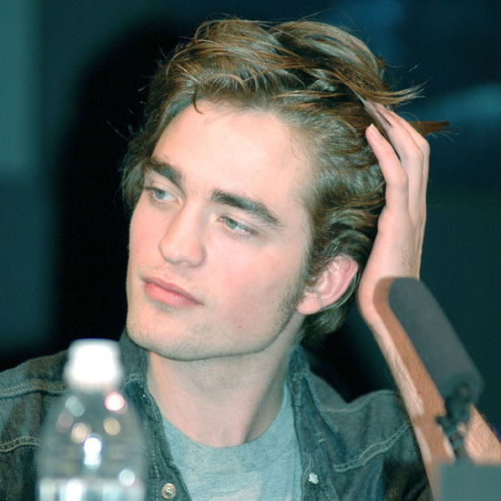 He pushed back his untamed locks at the November 2005 Harry Potter Tokyo press conference.