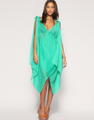 A bright teal hue and cool drape effect.  ASOS Chiffon Tie Maxi Beach Dress, $19