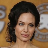 At the 2009 SAG Awards, Angelina wore an elegant low bun and her signature makeup look.