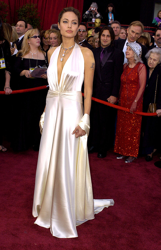 For the 2004 Oscars, Angelina wore a silk ivory gown with a plunging neckline and matching wrap designed by Marc Bouwer.